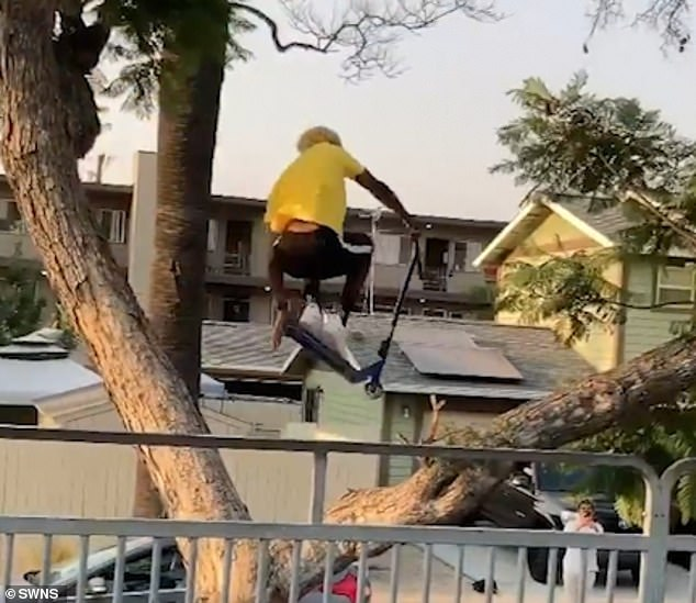 Dejion Taylor, 20, from Long Beach, California,leaps through a forked tree on his scooter