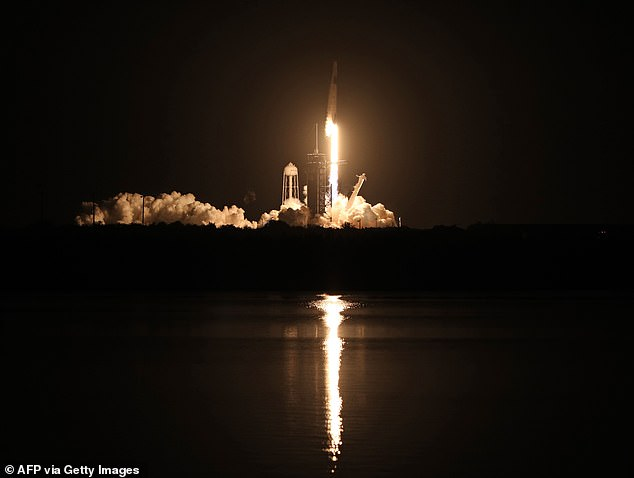 The returning astronauts, Crew-1, launched to the ISS on November 15, 2020 (pictured) and the team of four named their capsule Resilience given all the challenges in 2020, most notably the global pandemic.