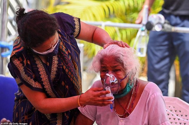 An elderly Covid patient is given oxygen at a Sikh Gurdwara, or place of worship, in the city of Ghaziabad after hospitals overflowed and were unable to treat her