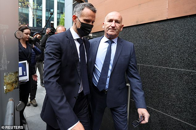 Ryan Giggs, 47, was seen arriving at Manchester Magistrates Court wearing a black suit, white shirt and a dark blue tie, surrounded by a large security escort