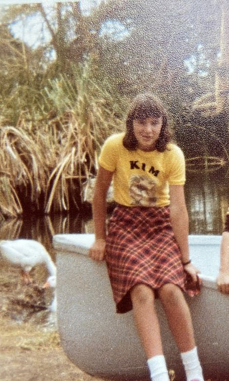 Kim is pictured at 16 in Africa