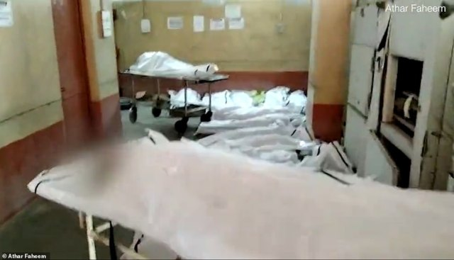 Footage shot at a hospital in Ahmadabad four days ago showed the morgue filled with bodies awaiting identification by relatives so they could be buried