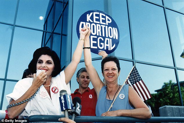 Attorney Gloria Allred, left, poses with Norma McCorvey, who was known as 'Jane Roe' in the landmark Roe vs. Wade court case. The pair appeared at a pro-choice rally in Burbank, Calif., on July 4, 1989
