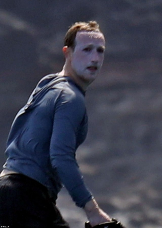 Mark Zuckerberg says the images of him plastered in sunscreen was part of a failed attempt to disguise himself from photographers while surfing in Hawaii