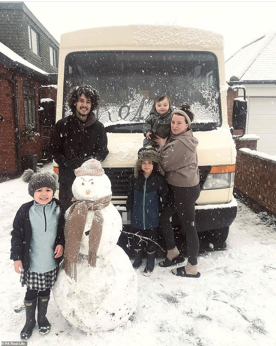 Thariea said she used Pinterest to get inspiration for the interior, meanwhile River researched the DIY skills needed to turn the bus into a home. Pictured: The family with their bus during winter