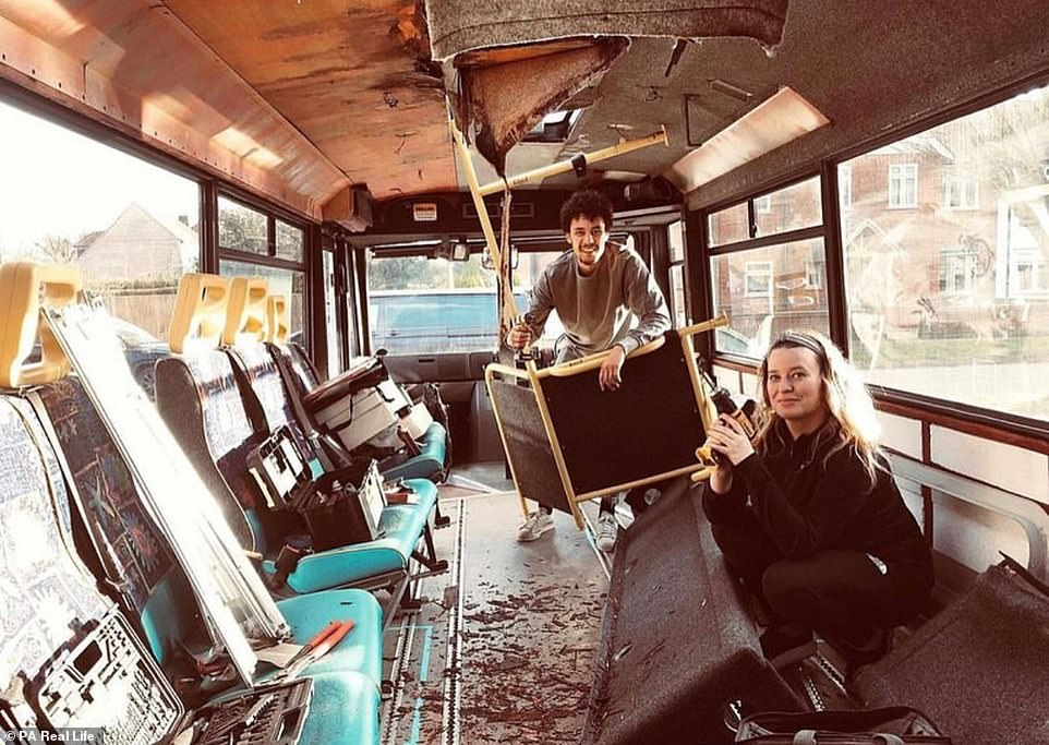 Thariea explained they haven't finished overhauling the bus but after a one-night sleepover on March 27, the children didn't want to leave. Pictured:Thariea and River get to work turning the bus into their new home