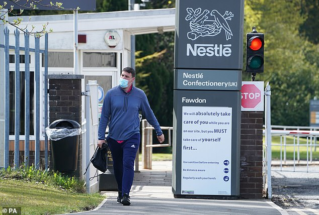 An employee leaves the Nestle factory at Fawdon, near Newcastle, after the company announced that it is planning to cut almost 600 jobs in the UK
