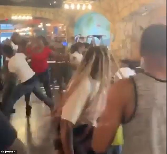 After chucking restaurant supplies at each, the warring families began a fist fight before running from the restaurant after police were called.
