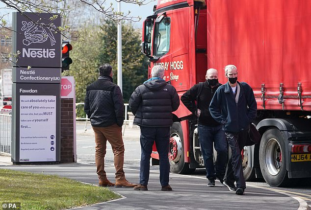 People outside the Nestle factory at Fawdon, near Newcastle, after the company announced that it is planning to cut almost 600 jobs in the UK