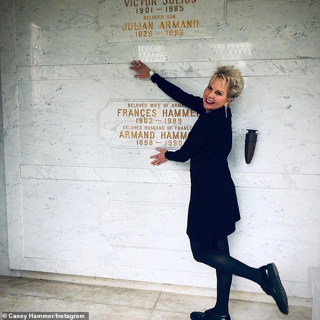 Hammer - who has $100 in savings and is estranged from much of her family - told the site: 'As a survivor I want to help empower others to speak up and know that they are heard'(pictured in 2019 at her grandparents' tomb)