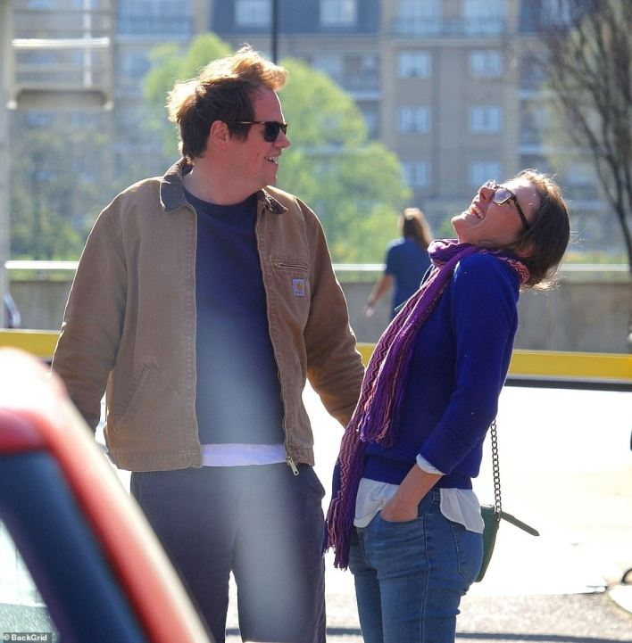 Tom smiles on as he female friend throws back her head in laughter after sharing a meal in west London, following the easing of Covid restrictions across England on April 12 with outdoor dining and drinking now permitted