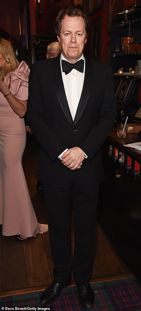 The stepson of Prince Charles, who is said to be close to the future King, is pictured attending the Vinar Carmen Cigar Smoker of the Year Awards 2019 in London