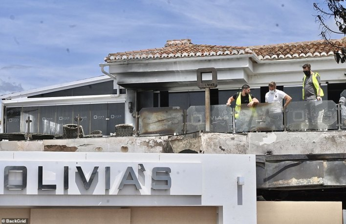Spanish police officers have been charged with carrying out a 'full investigation' into the cause of the blaze, which the reality star has suggested was an arson attack carried out by a 'scumbag'