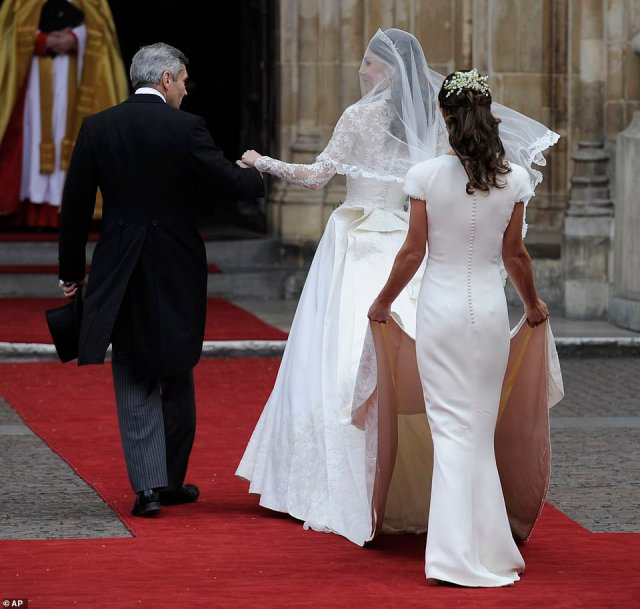 Maid of Honour Pippa helps her sister to the Abbeyat the Royal Wedding of Prince William of Wales to Kate Middleton on April 29, 201