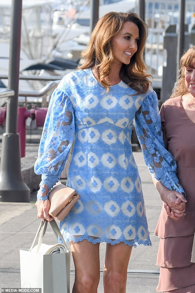 Ladylike:The former WAG looked ladylike in a blue lace mini-dress with puffy sleeves from designer Nicola Finetti