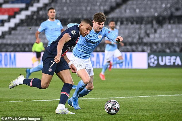 Mbappe (left) was kept in check by John Stones (right) as he failed to have a shot on target