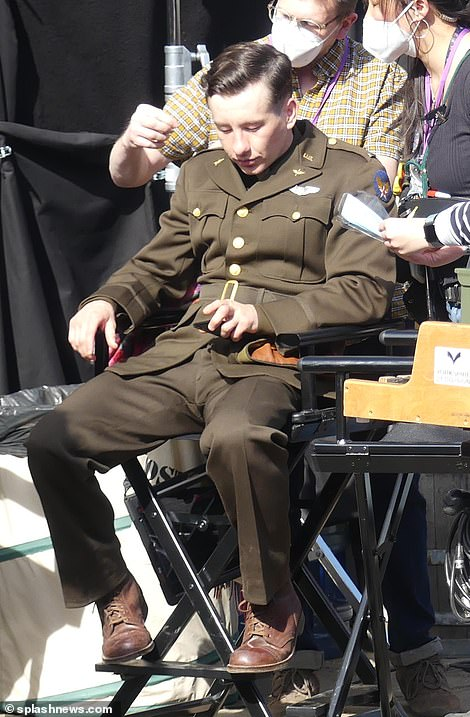 Taking a break? He was seen reclining in a chair on the set during a short respite from the filming day