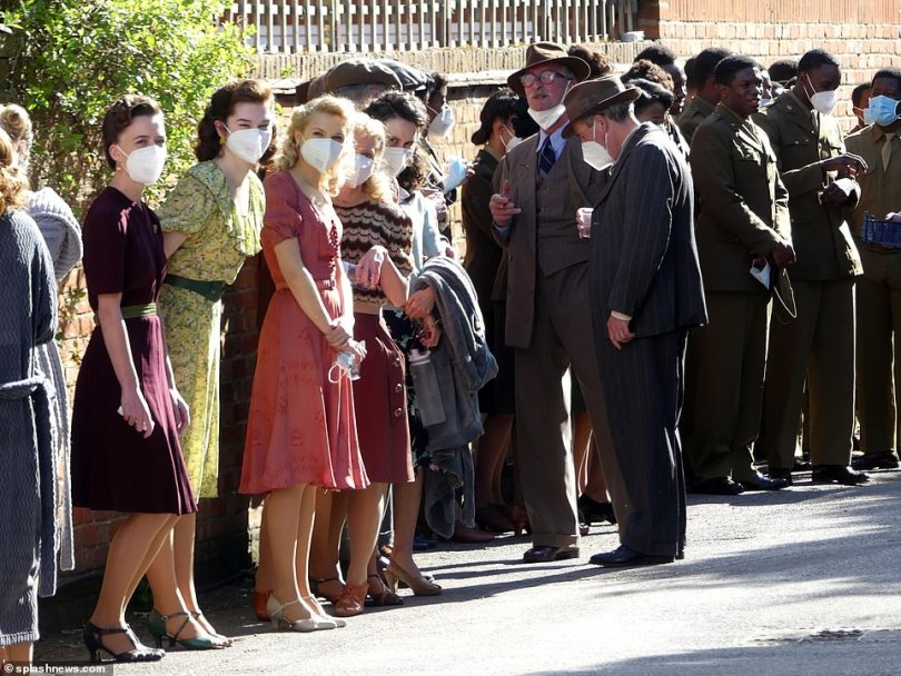 Taken back in time:The sleepy village of Bray was transported back to the 1940s with a slew of extras to film the scenes at the Hinds Head pub