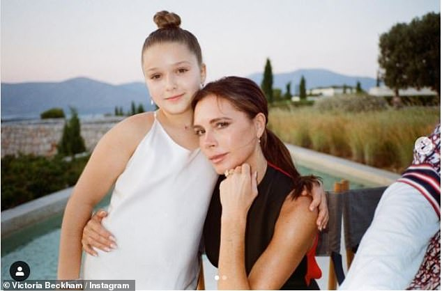 Family: Victoria shares daughter Harper (pictured together) with husband David as well as Romeo, 18, Cruz, 16 and Brooklyn, 22