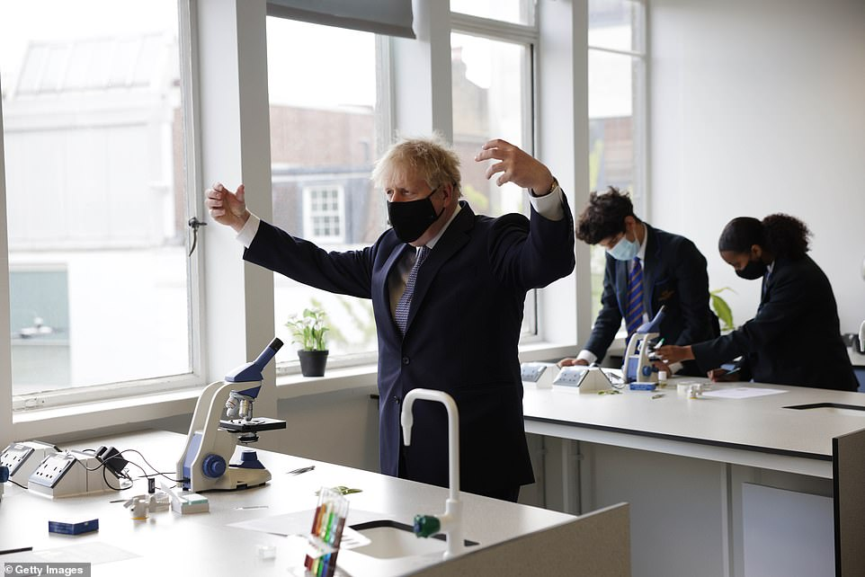 Prime Minister Boris Johnson takes part in a science lesson at King Solomon Academy in Marylebone, London this morning