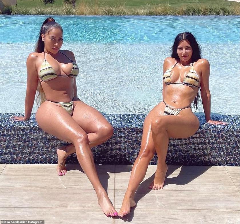 Fresh-faced:Brunette beauty Kim happily posed up with BFF La La Anthony at mother Kris Jenner's Palm Springs mansion this week - as the pair sizzled in bikinis