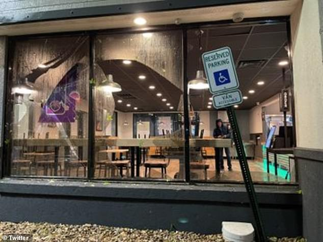 Broken windows are seen at the Taco Bell in Norman, Oklahoma, after the storm