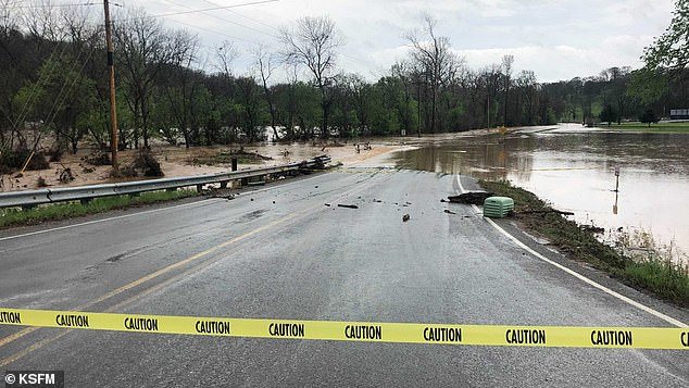 Meanwhile, a slow moving storm system swept across parts of Missouri and northwest Arkansas (pictured), causing severe flooding in both states