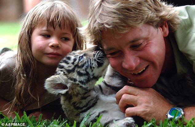 Remembering: 'When my children can take the football I call wildlife conservation and run it up. When they're ready to run up our mission. I will gladly step aside,' Steve can be overheard saying. Pictured: Brisbane, 2003