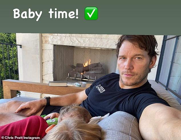 'Baby time': Chris Pratt relaxed on a balcony sofa next to an outdoor fireplace with daughter Lyla, eight months, and son Jack, eight, snuggled up beside him in this Instagram snap