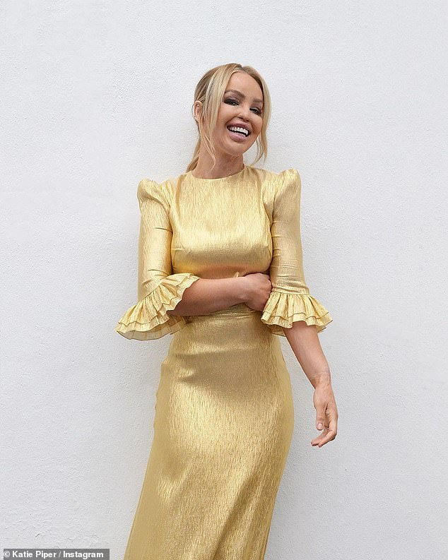Fashion maven:Katie Piper cut a stylish figure in a gold midi dress as she took to Instagram on Thursday