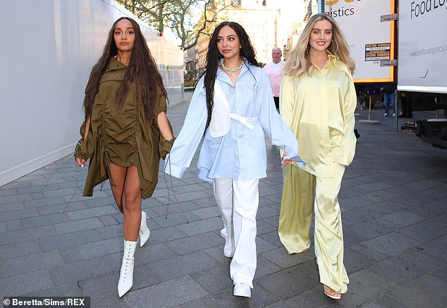Incredible: Blonde beauty Perrie commanded attention in her flowing trousers and oversized shirt which she slightly tucked in on one side to highlight her slim figure