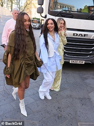 Exciting times: Jade appeared to be in great spirits as the trio arrived at the radio studios, beaming a mile at the cameras