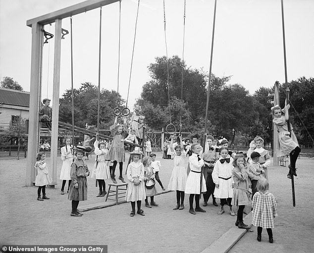 Girls can be seen playing on the gymnasium in a playground at Harriet Island, St. Paul in Minnesota, America in 1905 (pictured)