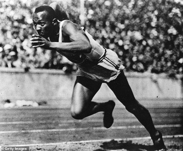 Jesse Owens, who equalled the record in winning the 100 metres yesterday, smashed the 200-metres Olympic figure today by winning a heat in the remarkable time of 21.1sec