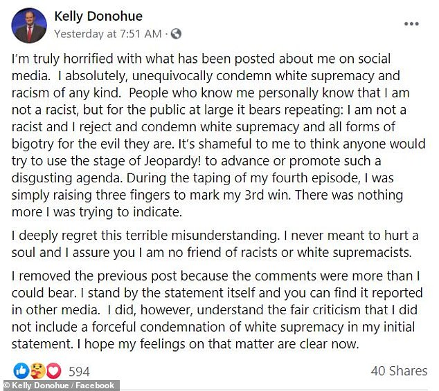 'I absolutely, unequivocally condemn white supremacy and racism of any kind,'Kelly Donohue wrote in a Facebook posting after being accused of making a racist gesture