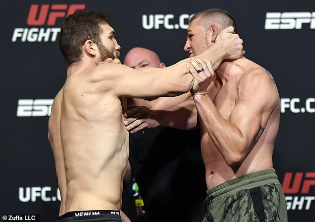 Ion Cutelaba (left) grabbed Dustin Jacoby's neck at the UFC Vegas 25 weigh-in on Friday