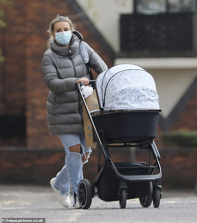 Simple:The star briefly picked up the tot before placing him back in his pram as they headed home following a day of shopping in the capital
