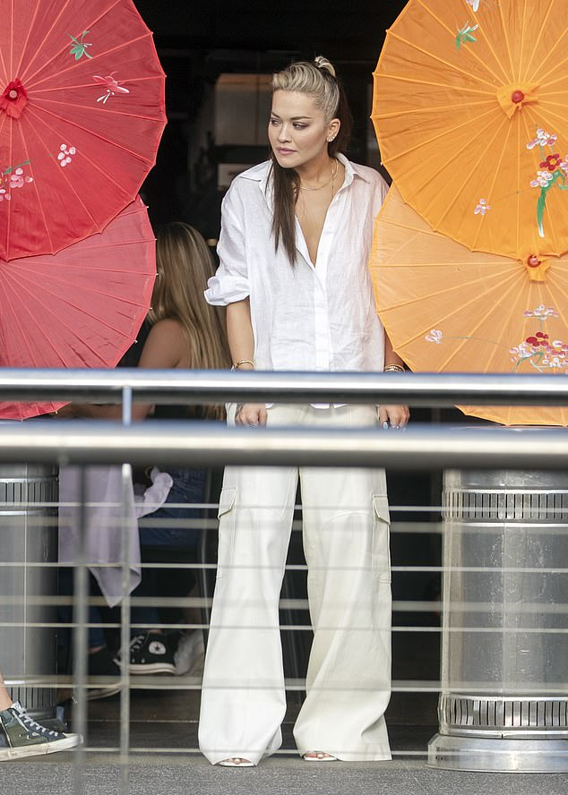 Lunch date:It was a meeting of showbiz minds in Woolloomooloo on Friday as A-list pals Rita Ora (pictured), her rumoured 'love interest' Taika Waititi, Russell Crowe, Christian Bale, Sacha Baron Cohen and Isla Fisher enjoyed dinner at the China Doll restaurant in Sydney