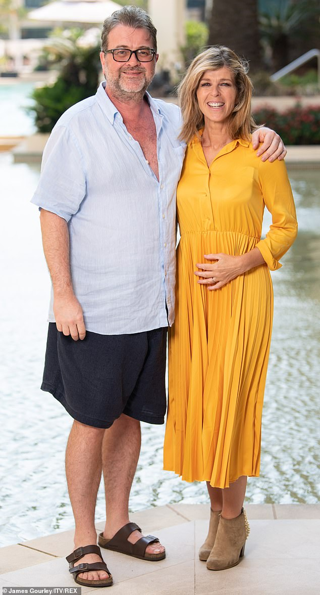 Support: Kate Garraway has revealed how her pal Piers Morgan 'went into Churchillian rallying mode' to help her during her husband Derek's Covid battle (pictured with Derek in 2019)