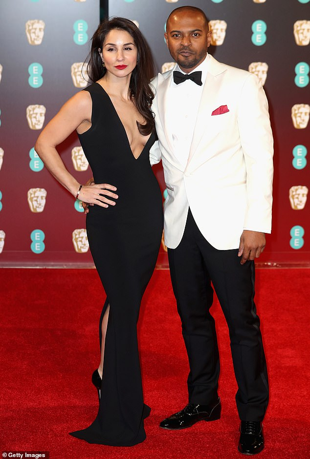 Response:Noel (pictured with his wife Iris Da-Silva in 2017) has apologised 'deeply' for his actions but 'vehemently' denied sexual misconduct or criminal behaviour