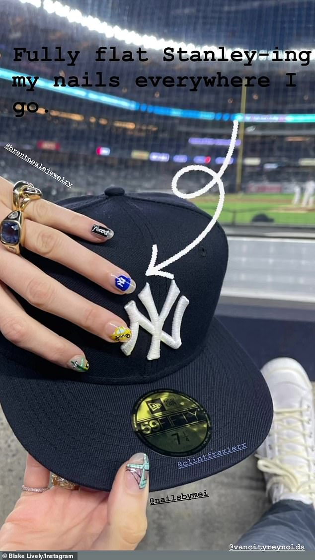 'Fully flat Stanley-ing my nails everywhere I go,' she mused while flashing her impressive nail art on a Yankees baseball cap