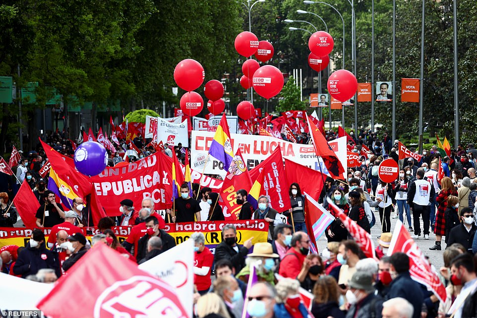 MADRID, SPAIN: Hundreds march through the streets of the Spanish capital on Saturday to celebrate workers' rights