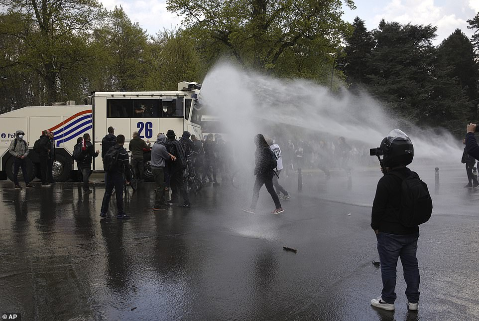 BRUSSELS, BELGIUM: The water cannon was also used to disperse a crowd of demonstrators earlier today