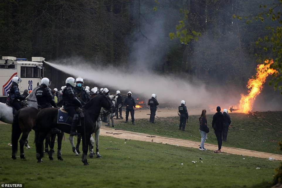 BRUSSELS, BEKGIUM: Police use a water cannon to put out a fire at the Bois de La Cambre park in Brussels, Belgium, earlier today