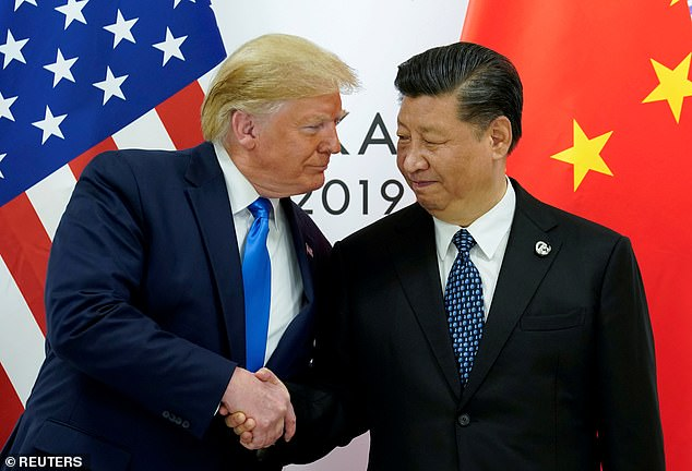 Pictured: Donald Trump shaking hands with Jinping at the G20 summit in 2019