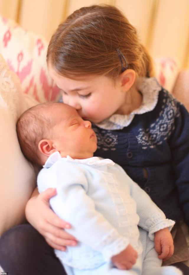 Age three: A handout photo released by the Duke and Duchess of Cambridge showing Princess Charlotte with her brother Prince Louis in a pictured taken by her mother at Kensington Palace in London