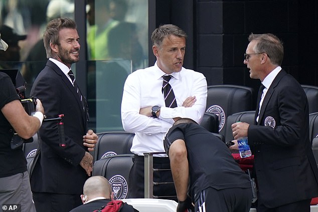 Neville (M) is adamant that he was not 'given' the job by his old friend and David Beckham (L)