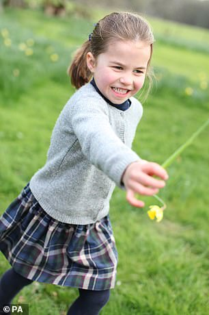 When aged four, a picture of Princess Charlotte showed the young royal holding a flower as she ran through a field, similar to a snap of her great-grandmother at that age