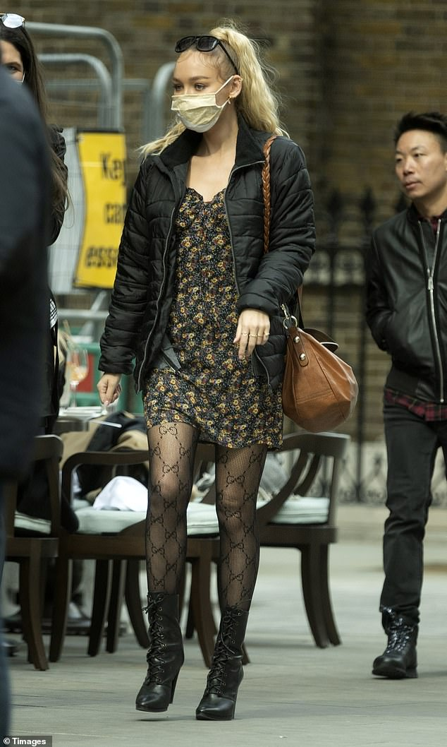 Work it!Roxy Horner looked typically cool as she covered her tiny floral dress with a black padded coat while she enjoyed lunch with friends in London on Sunday