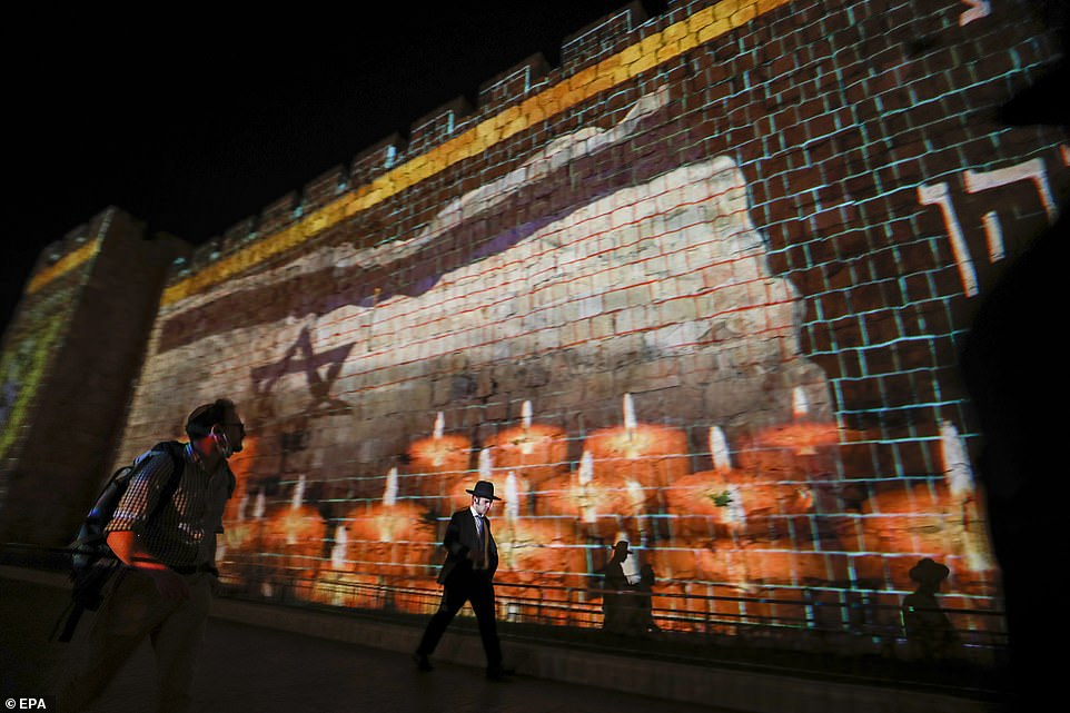 The walls of Jerusalem's old city were illuminated with the Israeli flag and candles on May 1 in mourning of the 45 people who were killed during the Lad Ba'Omer stampede on Thursday
